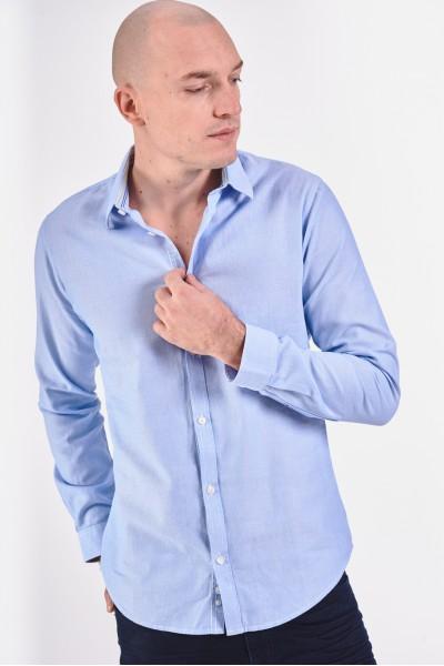 Elegancka błękitna koszula...