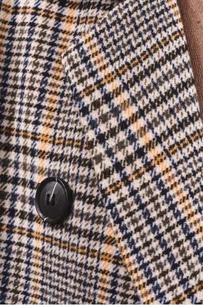 Przejściowy płaszcz w kratę